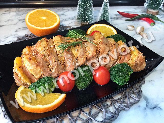 Свинина «Праздничная» с чесноком и апельсинами.